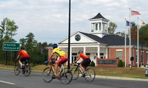 cyclist passing by an official building